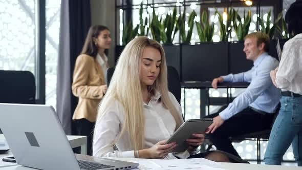 Thumbnail for Young Blond Businesswoman Get Acquainting with Information on the Tablet PC at the Workplace