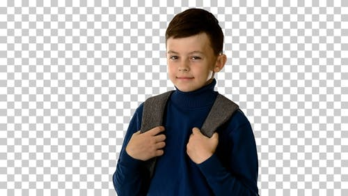 Boy in polo neck walking with a backpack, Alpha Channel