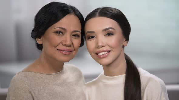 Thumbnail for Two women looking into camera, family love, healthy skin regardless of age