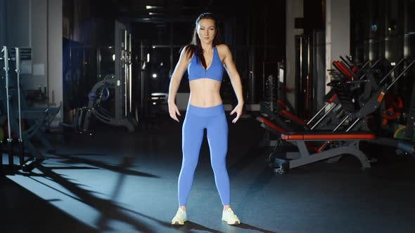 Thumbnail for Woman in Blue Fitness Leggings Stretches Neck Shoulders and Wrists Gym