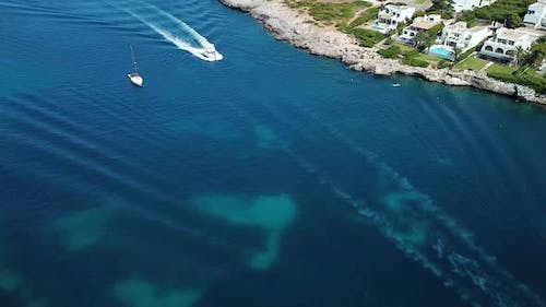 Aerial: The bay of Cala D'Or resort town in Mallorca, Spain