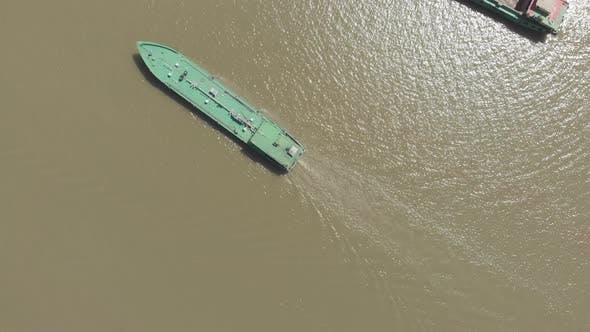 Thumbnail for Aerial: cargo ship riding on the Mekong River Delta region, Can Tho, South Vietnam