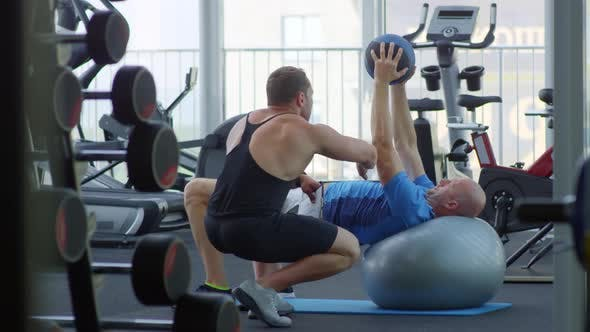 Thumbnail for Man Training with Medicine and Yoga Ball