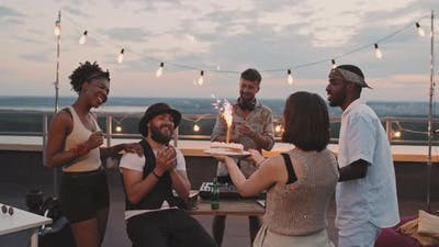 People Celebrating Friends Birthday on Rooftop Terrace