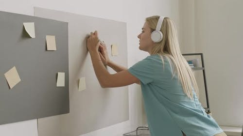 Girl Writing on Sticky Notes