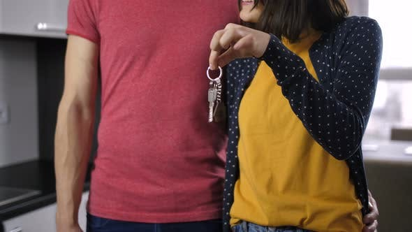 Thumbnail for Midsection of Happy Couple Shaking New House Key