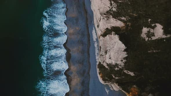 Top View, Drone Flying Directly Above Famous White Cliffs at Normandy Sea Shore, Calm Azure Waves