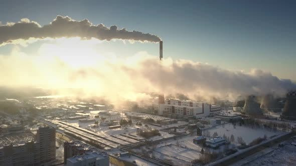 Cover Image for Bird Eye View Gray Smoke Blown From Pipe By Wind at Sunrise
