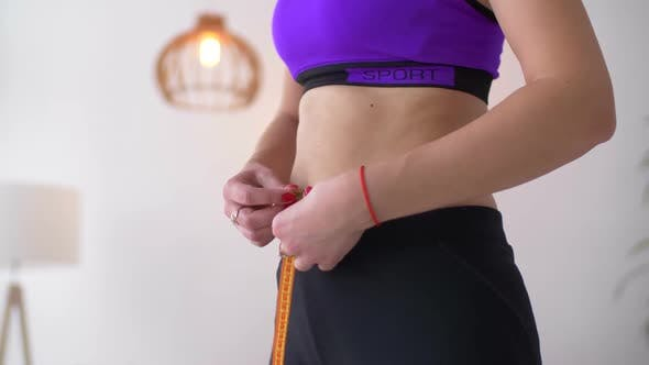 Thumbnail for Midsection of Fit Woman Measuring Her Waist
