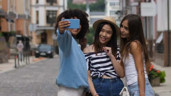 Thumbnail for Cheerful Selfie Diverse Girls Posing on City Street