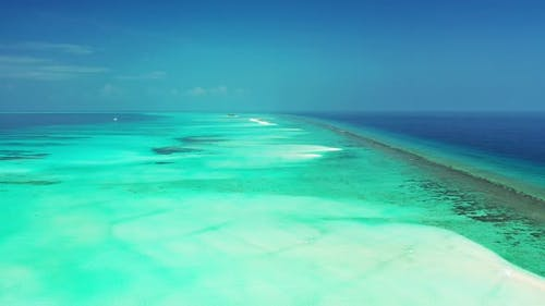 Wide angle fly over copy space shot of a sunshine white sandy paradise beach and turquoise sea backg