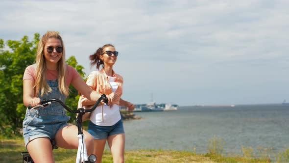 Thumbnail for Teenage Girls or Friends with Bicycle in Summer