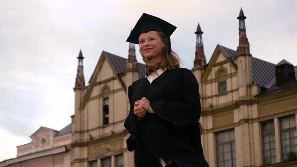 Thumbnail for Scholarship Opportunity and Education Success Concept. Beautiful Graduate Girl Smiling.
