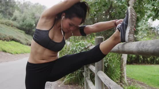 Thumbnail for Healthy Asian woman stretching at the park
