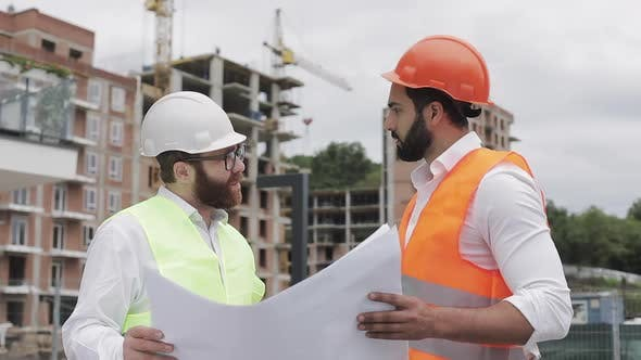 Thumbnail for Male Construction Engineer Discussion with Architect at Construction Site or Building Site