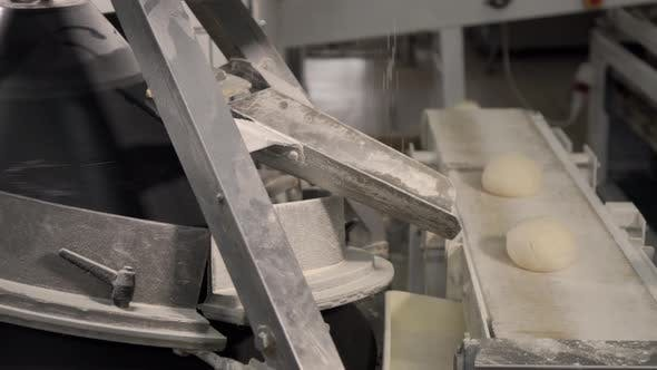Thumbnail for Making a Loaf of Bread in the Bakery. Loaf of Bread on the Production Line in the Baking Industry