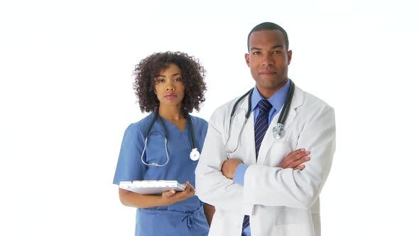 Thumbnail for Two African-American doctors standing looking at camera