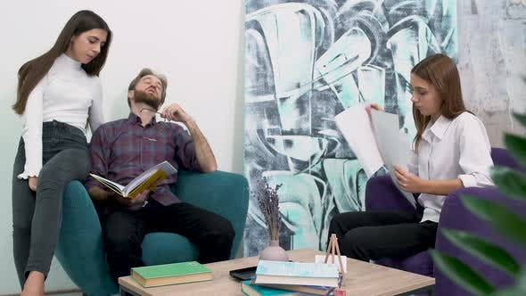 Cover Image for Office Workers Sitting in Comfortable Armchairs and Study Papers