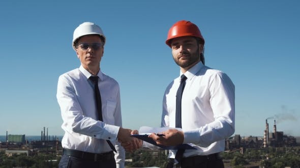 Thumbnail for Two Young Male Architects or Engineers Make Deal
