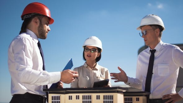 Thumbnail for Three Architects or Engineers Having a Meeting