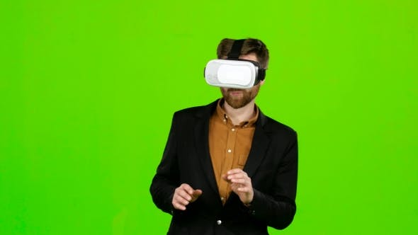 Thumbnail for Guy in the Virtual Glasses Is Watching an Interesting Movie. Green Screen