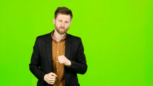Thumbnail for Man Is Standing in a Rack and Boxing. Green Screen