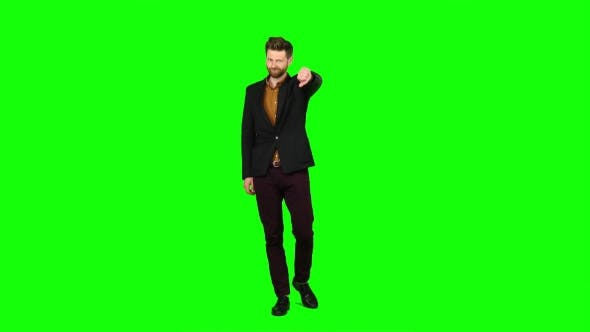 Thumbnail for Man Watches a Movie and Punches His Finger Down. Green Screen
