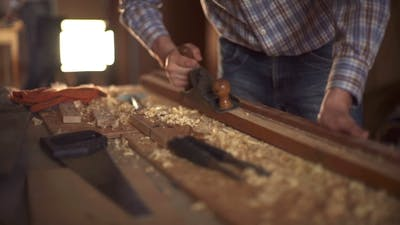 The Carpenter Sweeps the Shavings Off the Wood with Wood