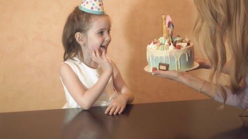 Children's Birthday Party. Birthday Cake for Little Birthday Girl. Family Celebration