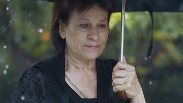 Thumbnail for Woman with Umbrella Under Rain
