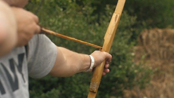 Thumbnail for Man Shoots an Arrow