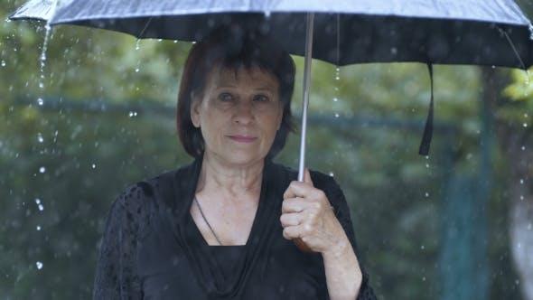 Thumbnail for Sad Woman Under Umbrella