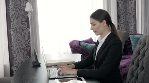 Woman Using Laptop in Modern Presidential Suit