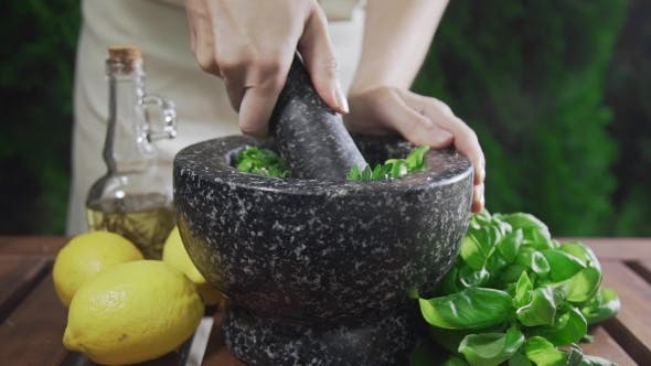 Thumbnail for Housewife Grinds the Basil for Pesto Sauce Outside, Cooking Food, Spicy Food, Vegetarian Meal