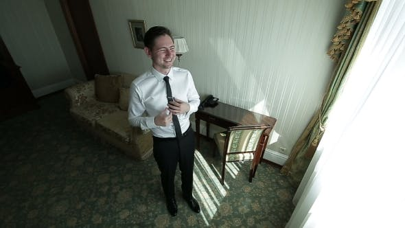 Happy Young Businessman in Hotel