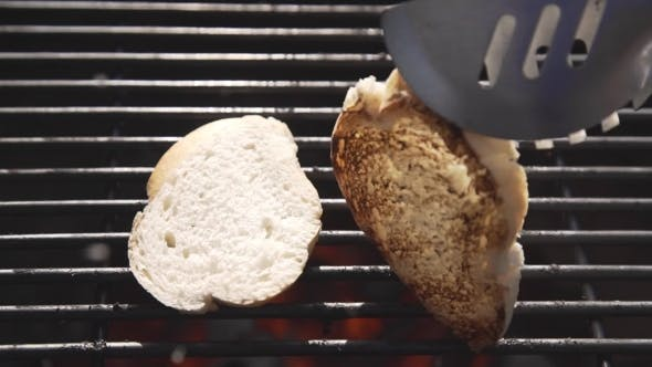 Thumbnail for Pieces of White Bread Are Grilling on the Open Fire Outside, Grill and Barbecue, Bbq at the