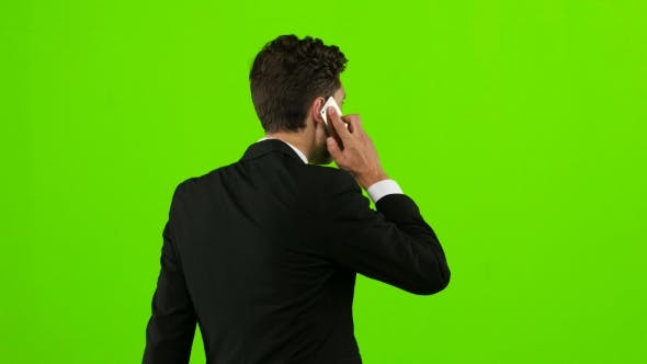 Thumbnail for Man Goes To Work and Talks on the Phone. Green Screen