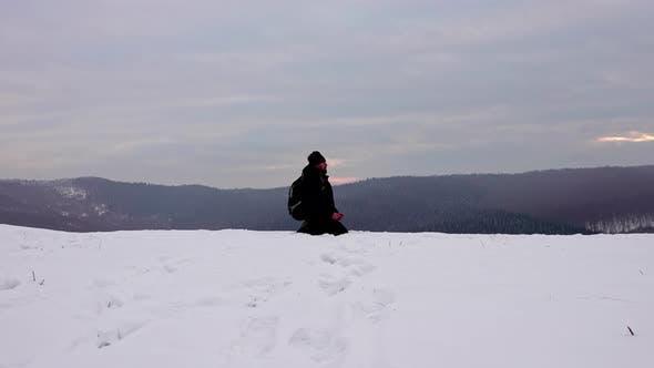 Hiker meditating after a day hike
