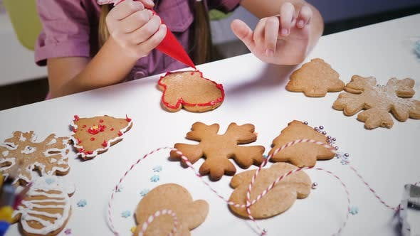 Thumbnail for Decorating gingerbread Christmas cookies