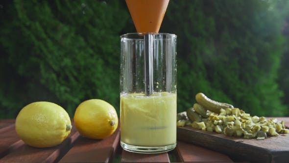 The Cook Blends Sauce Ingredients in a Long Glass, Cooking Outdoors, Cooking Food, Vegetarian Meals