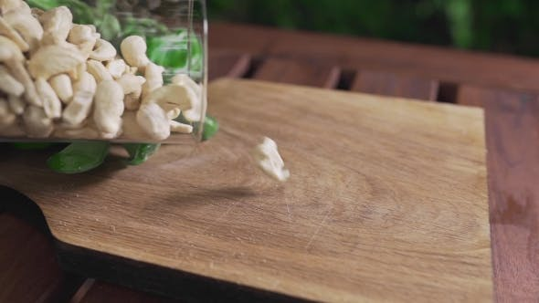 Thumbnail for Cashew Nuts Falls on the Wooden Board, Ingredients for Pesto Sauce, Vegetarian Food, Diet and