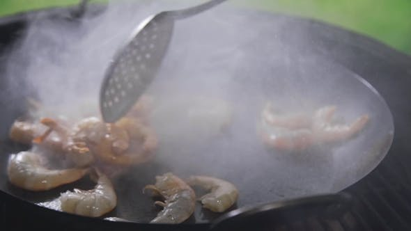 Prawns Are Frying in the Boiling Oil on the Open Fire, Grilling Prawns, Seafood Meal, Asian Cuisine