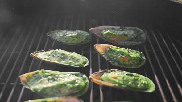 Mussels Is Roasted in the Sauce on the Open Fire of Grill, Cooking Outdoors, Seafood Barbecue