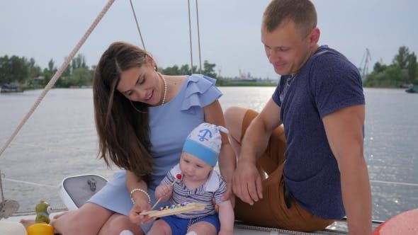 Young Married Couple with Son Resting on Yacht, Husband and Consort with Infant Relaxes on Pleasure