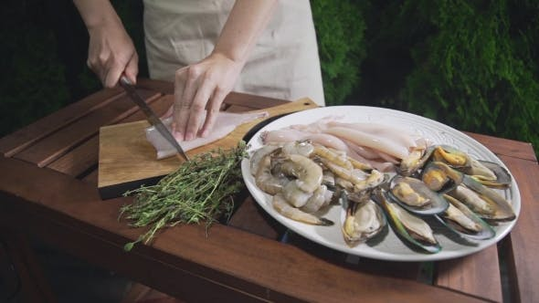 Thumbnail for The Cook Is Slicing Raw Calamari on the Wooden Board, Chef Prepares Seafood for Cooking Asian