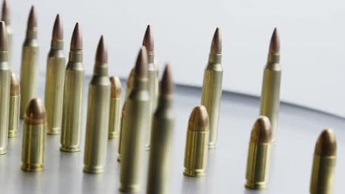 Cinematic rotating shot of bullets on a metallic surface - BULLETS 078