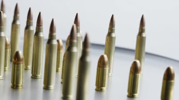Thumbnail for Cinematic rotating shot of bullets on a metallic surface - BULLETS 078