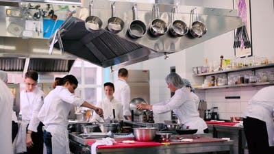 The Cooks Working on the Kitchen in the Restaurant