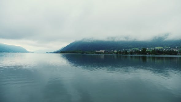 Thumbnail for Mountain Lake in the Austrian Alps. Fog, Early Morning. Pan Shot