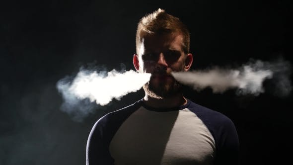 Thumbnail for Guy Smokes an Electronic Cigarette, Enjoy the Moment. Black Background